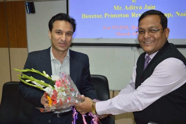 Dr. Tapan Kumar Nayak Presenting Floral Greetings to Mr. Aditya Jain, Director, Princeton Review Group